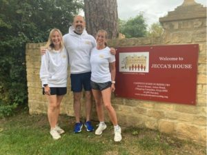 Runners in front of Campden Home Nursing sign