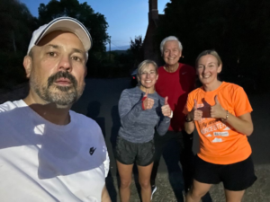 Four runners who are raising money for Campden Home Nursing
